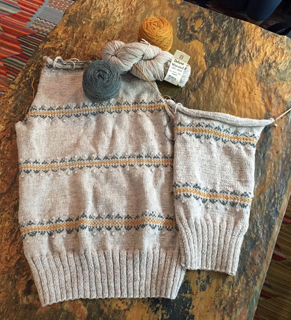 I'm on my way with the Zuni Cardigan knitting pattern! Back done and almost one front, too.