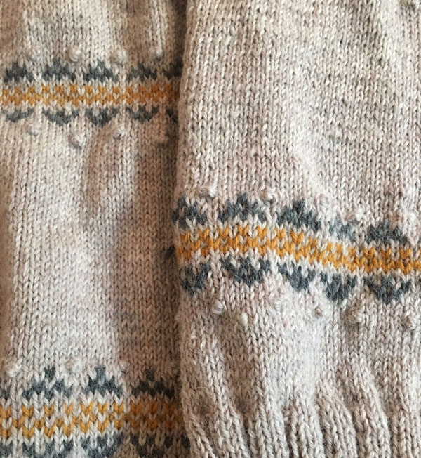 The Zuni Cardigan knitting pattern. The right piece is knitted on 5s and the left on 4s.